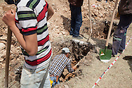 Grave diggers working at Soma cemetery during the third day of the Soma mining disaster, as bodies continue to be recovered. An electrical fault caused an explosion in the shaft resulting in at least 282 workers being killed in the disaster. Soma, Western Turkey.