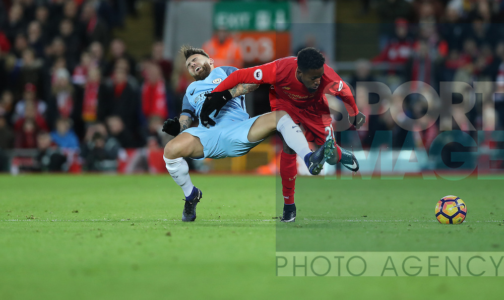 Nicolas Otamendi of Manchester City and Divock Origi of Liverpool during the English Premier League match at Anfield Stadium, Liverpool. Picture date: December 31st, 2016. Photo credit should read: Lynne Cameron/Sportimage