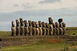 Chile, Easter Island: Array of statues or moai on a platform or ahu at Ahu Tongariki, near the quarry Rano Raruku.  This is the largest array of moia on Easter Island, consisting of 15 moai..Photo #: ch243-32737.Photo copyright Lee Foster www.fostertravel.com lee@fostertravel.com 510-549-2202