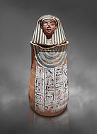 Ancient Egyptian Human headed canopic jar for Amenemheb, clay, New Kingdom, 19th Dynasty (1292-1190 BC), Deir el-Medina. Egyptian Museum, Turin. Old Fund cat 3471. Grey background.<br /> <br /> The canopic jars were four in number, each for the safekeeping of particular human organs: the stomach, intestines, lungs, and liver, all of which, it was believed, would be needed in the afterlife. By the First Intermediate Period jars with human heads (assumed to represent the dead) began to appear .<br /> <br /> If you prefer to buy from our ALAMY PHOTO LIBRARY  Collection visit : https://www.alamy.com/portfolio/paul-williams-funkystock/ancient-egyptian-art-artefacts.html  . Type -   Turin   - into the LOWER SEARCH WITHIN GALLERY box. Refine search by adding background colour, subject etc<br /> <br /> Visit our ANCIENT WORLD PHOTO COLLECTIONS for more photos to download or buy as wall art prints https://funkystock.photoshelter.com/gallery-collection/Ancient-World-Art-Antiquities-Historic-Sites-Pictures-Images-of/C00006u26yqSkDOM