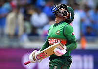Cricket - 2019 ICC Cricket World Cup - Group Stage: Bangladesh vs. India<br /> <br /> Bangladesh's Mushfiqur Rahim dejected as he is caught by India's Mohammed Shami off the bowling of India's Yuzvendra Chahal for 24, at Edgbaston<br /> <br /> COLORSPORT/ASHLEY WESTERN