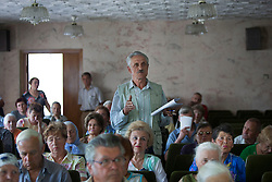 Mykola Shevchuk, 74, asks questions during a Òspecial consultationÓ held by attorneys and paralegals for potential clients who are children of the Second World War, Rivne, Ukraine, June 15, 2011. This vulnerable group is made up of seniors, most of whom are not receiving proper compensation as promised by the government. The legal team advises them on how to properly fill out forms and submit them to the courthouse, while encouraging them not to give up on their rights. More than half of the worldÕs population, four billion people, live outside the rule of law, with no effective title to property, access to courts or redress for official abuse. The Open Society Justice Initiative is involved in building capacity and developing pilot programs through the use of community-based advocates and paralegals in Sierra Leone, Ukraine and Indonesia. The pilot programs, which combine education with grassroots tools to provide concrete solutions to instances of injustice, help give poor people some measure of control over their lives.