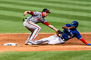 Washington Nationals third baseman Carter Kieboom tags Toronto Blue Jays outfielder Teoscar Hernández to stop the steal attempt on July 30, 2020 at Nationals Park.