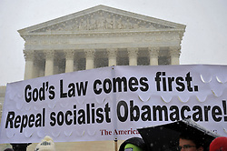 March 25, 2014 - Washington, DC, U.S. - Opponents of ''Obamacare'' and contraception rally in front of the U.S. Supreme Court as the court hears twin challenges to the healthcare law.  The cases, brought by two corporations, Hobby Lobby and Conestoga Wood Specialties, challenge a provision of the Affordable Care Act that requires many employers to provide female workers with comprehensive insurance coverage for a variety of methods of contraception. (Credit Image: © Jay Mallin/ZUMAPRESS.com)