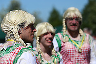 Coxheath, Kent - Saturday, May 22nd 2010: Bewigged members of a German team seen at the World Custard Pie Championships at Coxheath near Maidstone, Kent. The first championship was held in 1967 in Coxheath using a special custard recipe developed by Richard Hearn aka Mr Pastry. The championship is made up of teams competing in heats, semi finals and the final, with the number of pies available per team increasing from 5 in the heats to 10 in the final. 6 points are scored for a direct hit on the face, 3 points for the shoulders or upwards, 1 point for any other part of the body, and points are deducted for misses. A discretionary 5 points can be awarded for the most amusing and original throwing technique. The event is part of the Rotary Club funday. (Pic by Andrew Tobin/SLIK Images)