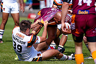 Bradford Bulls Edward Chapelhow (39) grabs a hold of Batley Bulldogs Wayne Reittie (2)  during the Kingstone Press Championship match between Batley Bulldogs and Bradford Bulls at the Fox's Biscuits Stadium, Batley, United Kingdom on 16 July 2017. Photo by Simon Davies.