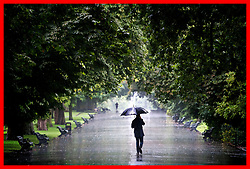 PABest A man walks through the rain in Regents Park, London, as wet weather continues to hit the UK.