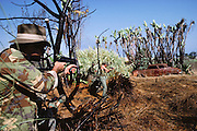 "Combatants playing war at ""Quest"" paintball combat park, Malibu, California, USA."