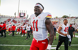 Sep 4, 2021; College Park, Maryland, USA; Maryland Terrapins linebacker Ruben Hyppolite II (11) celebrates after defeating the West Virginia Mountaineers at Capital One Field at Maryland Stadium. Mandatory Credit: Ben Queen-USA TODAY Sports