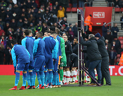 10 December 2017 Southampton : Premier League Football : Southampton v Arsenal : staff hold onto the Premier League banner in the strong wind.<br /> (photo by Mark Leech)