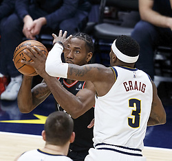 December 16, 2018 - Denver, Colorado, U.S - Raptors KAWHI LEONARD, left, goes in for a shot with Nuggets TORREY CRAIG, right, during the 2nd. Half at the Pepsi Center Sunday evening. The Nuggets beat the Raptors 95-86. (Credit Image: © Hector Acevedo/ZUMA Wire)