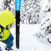 Forrest Jillson heads back up for another run in the Teton backcountry.
