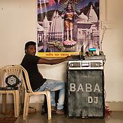 A DJ names Baba DJ prepares for a wedding.