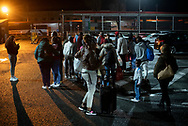A group of newly arrived migrants attend the instructions of a volunteer at the bus station. Irun (Basque Country). March 07, 2020. A group of volunteers has created a host network to serve migrants and inform about the public services they are entitled to and the ways to cross the border. This group of volunteers is avoiding a serious humanitarian problem Irun, the Basque municipality on the border with Hendaye. As the number of migrants arriving on the coasts of southern Spain incresead, more and more migrants are heading north to the border city of Irun. One of the functions performed by these volunteers is to direct the newcomers to the device the red cross has for migrants in transit, so that they can sleep in a safe place. (Gari Garaialde / Bostok Photo). Gari Garaialde / Bostok Photo)