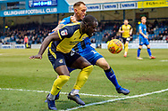 Scunthorpe United forward Olufela Olomola (24) and Gillingham FC defender Barry Fuller (12) during the EFL Sky Bet League 1 match between Gillingham and Scunthorpe United at the MEMS Priestfield Stadium, Gillingham, England on 16 February 2019.