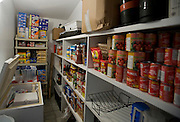 Sealift room (food storage room). One perk that the Melansons can take advantage of that isn't available to everyone in Nunavut is the sealift: bulk buying of staple foods to bring down the high price of food to this remote area. It comes in via ship from Canada's southern provinces. The image is part of a collection of images and documentation for Hungry Planet 2, a continuation of work done after publication of the book project Hungry Planet: What the World Eats, by Peter Menzel & Faith D'Aluisio.