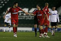 Johnnie Jackson (left) celebrtes his consolation goal for Colchester