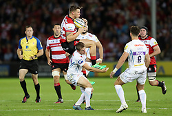 Gloucester's Jason Woodward is tackled illegally by Exeter Chiefs Gareth Steenson during the Aviva Premiership match at the Kingsholm Stadium, Gloucester.