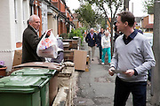 © Licensed to London News Pictures. 26/04/2015. Sutton, UK  NICK CLEGG talks to a local resident as he leaflets Orchard Road in Sutton. Deputy Prime Minister and Leader of the Liberal Democrats Nick Clegg makes a speech today, 26th April 215 in Sutton, to local Liberal Democrats in support of the candidate for Sutton and Cheam, Paul Burstow. Nick Clegg and Paul Burstow also joined local campaigners to deliver leaflets on a nearby street, and put up a Liberal Democrat stakeboard.. Photo credit : Stephen Simpson/LNP