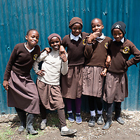 Schoolgirls pose for a picture on their way to school, Nairobi