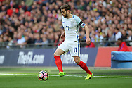 Adam Lallana of England dribbling during the FIFA World Cup Qualifier group stage match between England and Lithuania at Wembley Stadium, London, England on 26 March 2017. Photo by Matthew Redman.