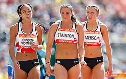 England's Katie Stainton (centre) with team mates Katarina Johnson-Thompson (left) and Niamh Emerson (right) after she fell during the 100m Hurdles element of the Women's Heptathlon, at the Carrara Stadium during day eight of the 2018 Commonwealth Games in the Gold Coast, Australia.