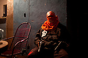 "In this Aug. 11, 2012 photo, a masked and armed trafficker poses for a photo at a drug selling point that no longer sells crack in the Mandela slum in Rio de Janeiro, Brazil. <br /> <br />  The South American country began experiencing a public health emergency in recent years as demand for crack boomed and open-air ""cracolandias,"" or crack lands, popped up in the sprawling urban centers of Rio and Sao Paulo, with hundreds of users gathering to smoke the drug. The federal government announced in early 2012 that more than $2 billion would be spent to fight the epidemic, with the money spent to train local health care workers, purchase thousands of hospital and shelter beds for emergency treatment, and create transitional centers for recovering users."