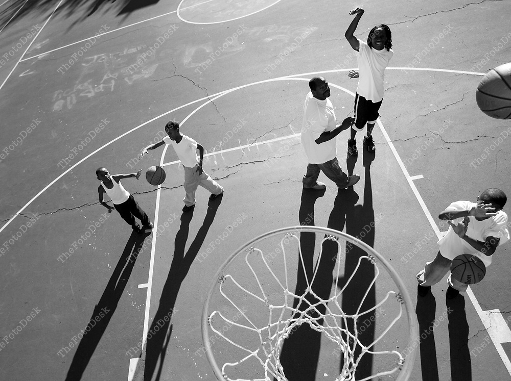 An African American male with boys playing basketball. (Brian Branch Price)