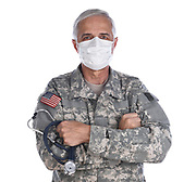 Military Doctor Wearing Camouflage Fatigues and Surgical Mask