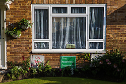 Sipson, UK. 5th June, 2018. Signs calling for no third runway at Heathrow airport are pictured inside and outside a house.