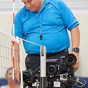 Fullerton, CA - A referee examines SportsShooter Academy student's remote setups during a volleyball match between Fullerton College and Saddleback College. on November 4th, 2016. Behind the Scenes with the cast and crew of Sports Shooter Academy.