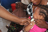 A nurse injects a child with immunization at Metero Reference Clinic in Lusaka, Zambia on Wednesday 12 November 2014.