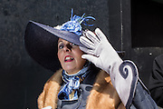 New York, NY, USA-27 March 2016. Glover Patricia Ann Parenti sporting a blue straw hat and elegant gauntlets in the annual Easter Bonnet Parade and Festival.