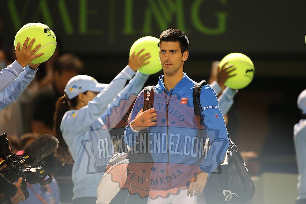 Novak Djokovic, of Serbia, enters the court area prior to his match against Martin Klizan, of Slovakia, at the Miami Open tennis tournament on Saturday, March 28, 2015 in Key Biscayne, Florida. Djokovic defeated Klizan 6-0, 5-7, 6-1(AP Photo/Alex Menendez)