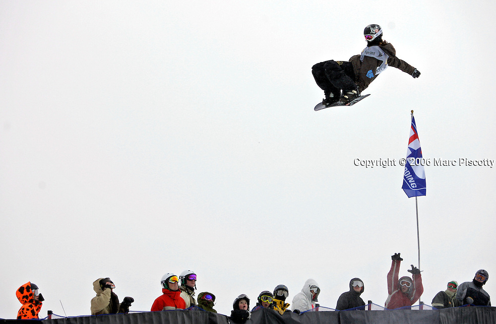 Spectators cheer as Shaun White of Carlsbad, Ca. flies above their heads during the halfpipe finals at the Chevrolet U.S. Snowboard Grand Prix in Breckenridge, Co. Saturday December 17, 2005. The Breckenridge event was the first of three stops in a series that will determine who will make the U.S. Snowboard Team and represent the country in the 2006 Winter Olympics in Torino, Italy. Shaun White of Carlsbad, Ca. won the men's event while Gretchen Bleiler of Snowmass Village, Co. won the women's event. The Grand Prix, now in its 10th year as the premier snowboard series in North America, features a cash purse of $340,000 and a new Chevrolet truck to the overall male and female winner of the series. White won the event with a score of 47.10 and with two wins already is guaranteed a spot on the U.S. Snowboard Team..(MARC PISCOTTY/ © 2006)