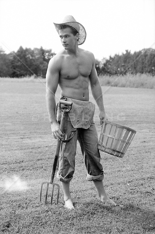 All American farmer without a shirt and shoes