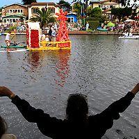 'Hoe Down at the Beach' is welcomed with open arms as the float constructed by the crew at Gayle's Bakery and Rosticceria  makes its way down Soquel Creek during the 59th annual Capitola Begonia Festival's Nautical Parade.<br /> Photo by Shmuel Thaler <br /> shmuel_thaler@yahoo.com www.shmuelthaler.com