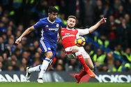 Diego Costa of Chelsea challenges Shkodran Mustafi of Arsenal . Premier league match, Chelsea v Arsenal at Stamford Bridge in London on Saturday 4th February 2017.<br /> pic by John Patrick Fletcher, Andrew Orchard sports photography.