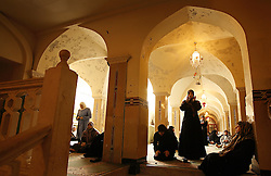 Women pray inside the Al-Hassanain Mosque in Haret Hreik, a predominantly Shia Muslim neighborhood in Beirut, Lebanon, April 14, 2006. Sayyed Mohammad Hussein Fadlallah is the imam of the mosque and was once considered the spiritual head of Hezbollah.
