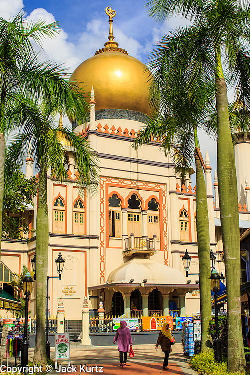 21 DECEMBER 2012 - SINGAPORE, SINGAPORE: Exterior of the Sultan Mosque in Singapore. The Sultan Mosque is the focal point of the historic Kampong Glam area of Singapore. Also known as Masjid Sultan, it was named for Sultan Hussein Shah. The mosque was originally built in the 1820s. The original structure was demolished in 1924 to make way for the current building, which was completed in 1928. The mosque holds great significance for the Muslim community, and is considered the national mosque of Singapore. It was designated a national monument in 1975.    PHOTO BY JACK KURTZ