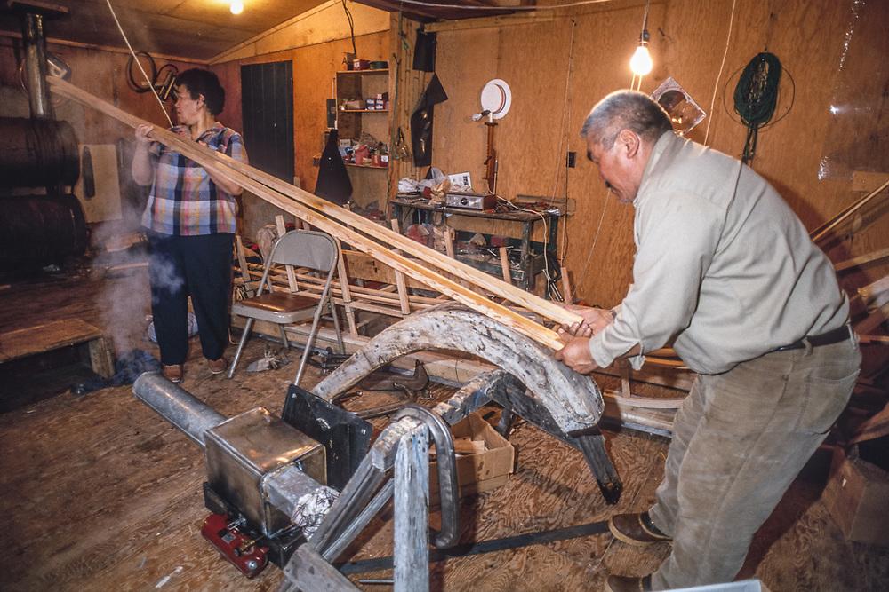 Don and Dolly Smith bending wooden skis for a cargo sled, Kiana, Alaska, USA