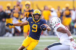 Oct 2, 2021; Morgantown, West Virginia, USA; West Virginia Mountaineers wide receiver Isaiah Esdale (9) runs after a catch during the third quarter against the Texas Tech Red Raiders at Mountaineer Field at Milan Puskar Stadium. Mandatory Credit: Ben Queen-USA TODAY Sports