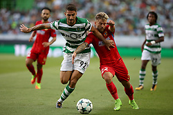 August 15, 2017 - Lisbon, Portugal - Sporting's defender Cristiano Piccini from Italy (R ) fights for the ball with Steaua's forward Catalin Golofca during the UEFA Champions League play-offs first leg football match between Sporting CP and FC Steaua Bucuresti at the Alvalade stadium in Lisbon, Portugal on August 15, 2017. (Credit Image: © Pedro Fiuza/NurPhoto via ZUMA Press)