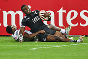 Joe Ravouvou is stopped by Carlin Isles, New Zealand against USA during day one at the Emirates Airline Dubai Rugby Sevens 1st December 2017.<br /> Copyright photo: Tom Kirkwood / www.photosport.nz