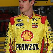 NASCAR Sprint Cup driver NASCAR Sprint Cup driver Joey Logano (22) is seen in the pits during the practice session prior to the NASCAR Sprint Unlimited Race at Daytona International Speedway on Saturday, February 16, 2013 in Daytona Beach, Florida.  (AP Photo/Alex Menendez)