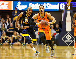 Feb 10, 2018; Morgantown, WV, USA; Oklahoma State Cowboys guard Kendall Smith (1) passes the ball up the floor during the first half against the West Virginia Mountaineers at WVU Coliseum. Mandatory Credit: Ben Queen-USA TODAY Sports