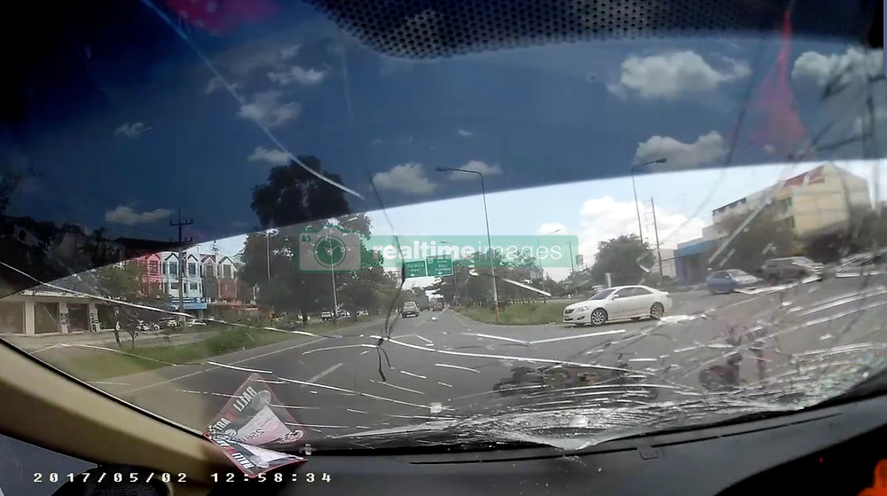 """Carelessness kills woman motorcyclist...Dashcam footage shows a driver and his passenger bickering as they drive along a main road in Thailand's Soghkla Province...However any distraction that the argument may have caused cannot be blamed for the accident that occurred when a female motorcyclist changed lanes in front of the car without checking...The result is obvious form the footage and the 19 year old motorcyclist sustained serious head injuries from which she later died  Her passenger was also seriously injured and remains in a serious condition...Obviously the accident would not have occurred if the woman had checked behind her before making the maneuver – especially as she was wearing a Muslim headscarf which would anyway have hindered her view and perhaps her hearing the car behind...Another major contributing factor was probably that she was not wearing a crash helmet.  The law about crash helmets is vague in Thailand  - most believe that the driver MUST wear one whilst the passenger need not.  In any even the law is seldom observed especially in remote areas – all this contributes to Thailand having the second worst road fatalities record in the world...The driver, a 29 year old known simply as Yo, said """"I had not yet paid my insurance so the repairs to my car will cost me 45,000 baht (approximately 1,000 pounds) and the motorcyclist won't be insured – they never are"""".©Exclusivepix Media (Credit Image: © Exclusivepix media via ZUMA Press)"""
