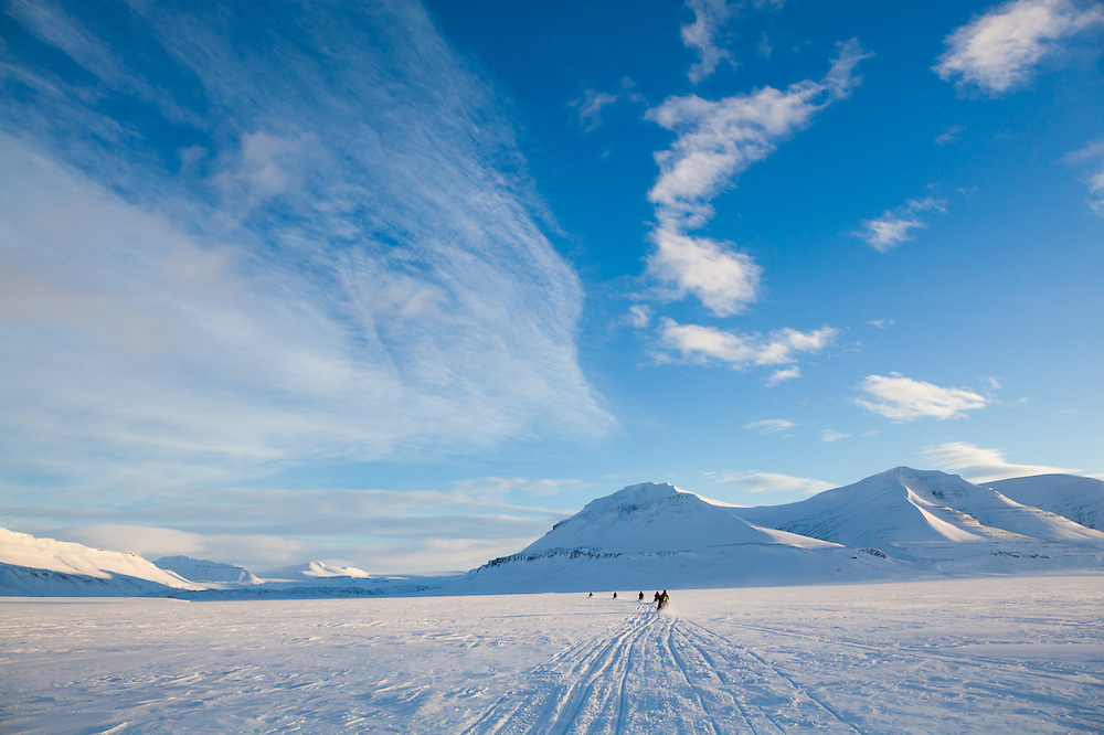UNIS students travel up Sassendalen, Svalbard on a class field trip by snowmobile to Tunabreen.