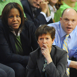 Notre Dame Fighting Irish head coach Muffet McGraw (kneeling) looks on with assistant coaches Carol Ownes (left) and Jonathan Tsipis (right) during second half NCAA Big East women's basketball action between Notre Dame and Rutgers at the Louis Brown Athletic Center. Notre Dame defeated Rutgers 71-41.