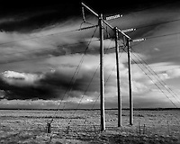 More Powerlines from a Bus on a Winter Day in Iceland. Image taken with a Leica X2 camera (ISO 100, 24 mm, f/7, 1/250 sec). Raw image processed with Capture One Pro and Focus Magic (to remove some of the motion blur).